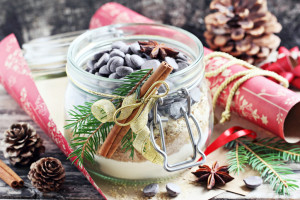 Edible gift Idea: oatmeal cookies mix in the glass jar on a rustic wooden table.Toned image.Selective focus