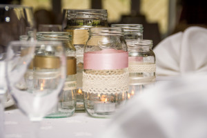 Candles in jam jars make lovely wedding favours and decorations.
