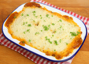 Home-made shepherds pie in traditional enamel dish.