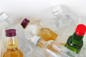 Minibar bottles with ice cubes, close-up