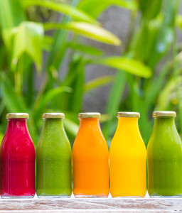 Organic cold-pressed raw vegetable juices in glass bottlesOrganic cold-pressed raw vegetable juices in glass bottles