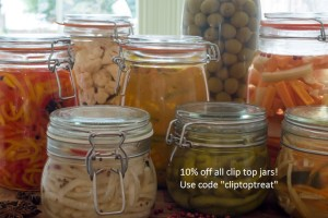 A close up selection of pickled and fermented vegetables in Kilner jars