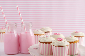 Pink retro striped theme dessert table at a girls birthday party horizontal
