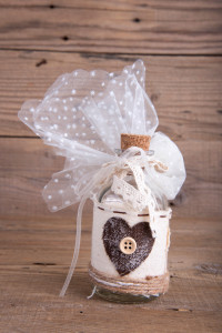 Glass bottle wedding favor christening on old wooden table