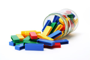 Building Blocks and Jar on White Background