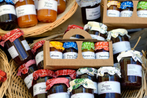 PROVENCE, FRANCE - JULY 15, 2014: Jars ofa different french marmalade at the rural market. Street markets very popular in Provence