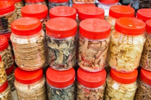 Variety Chinese New Year cookies in plastic jars